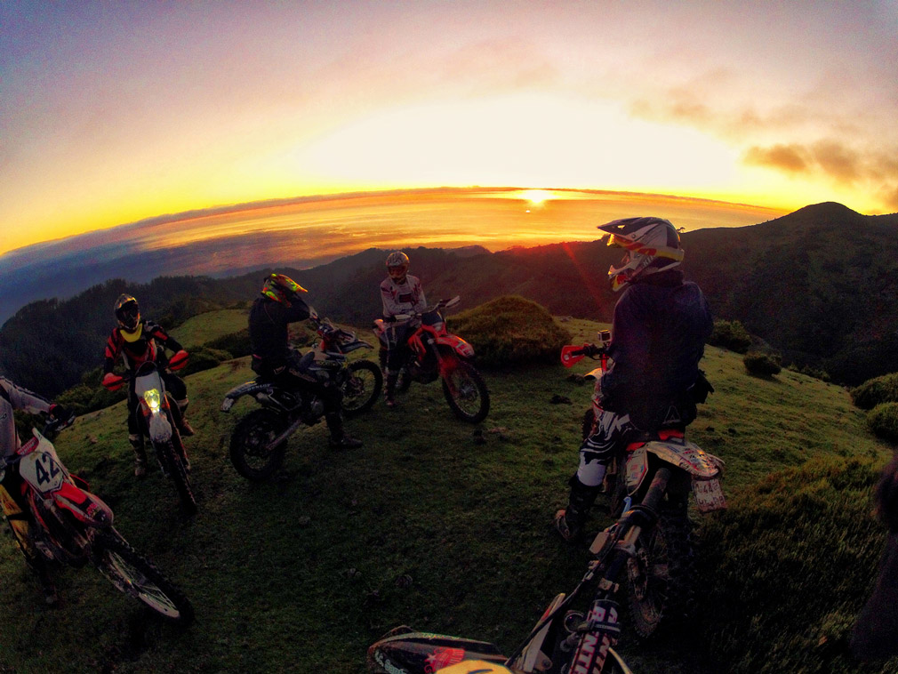 A panoramic shot of an enduro group on Madeira sunset