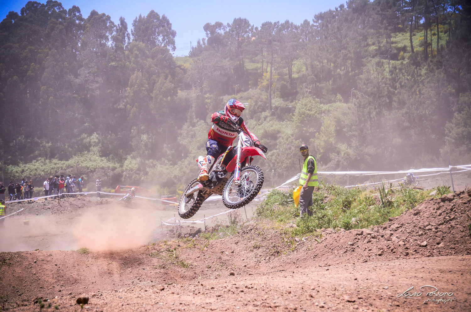 A Rider jumping on a motocross track