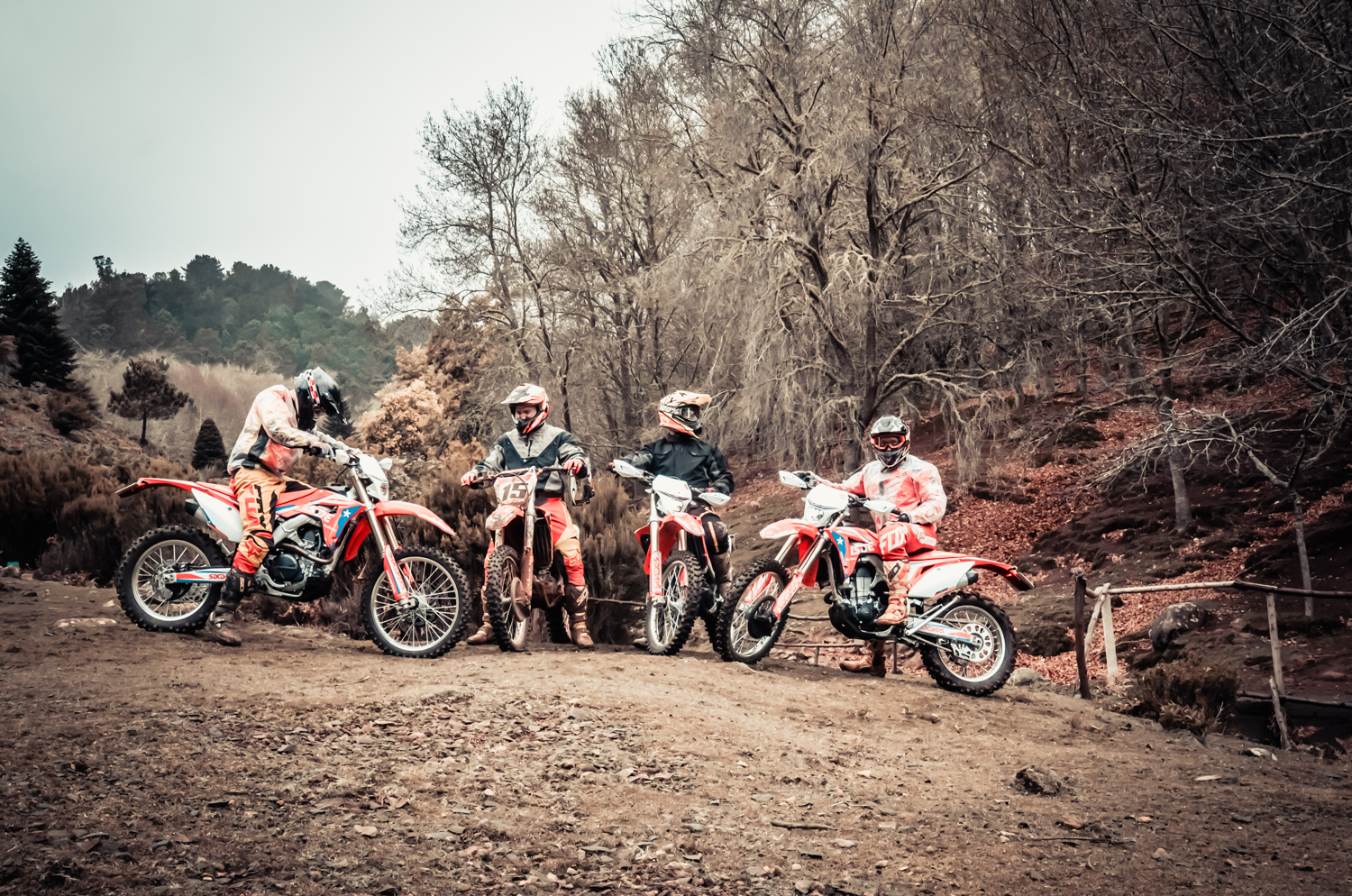Four riders pose for a photo with their hondas CRF450RX off-road