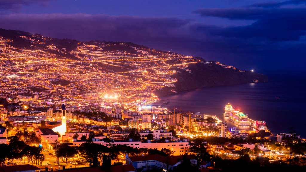 A photo of Funchal by night